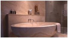 Akmens masės vonios
